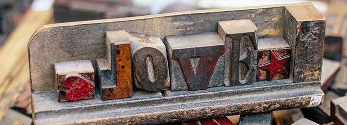 Love spelling with printing typesetting blocks